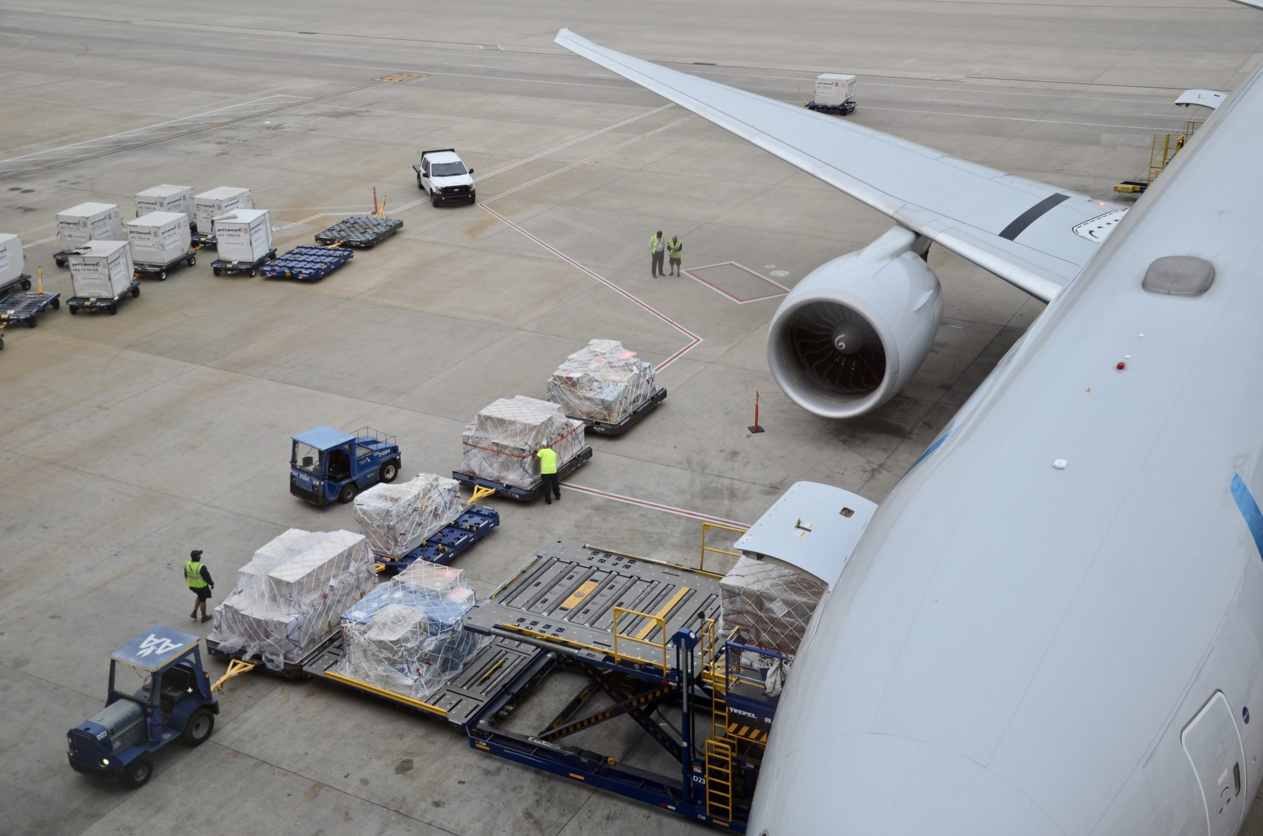 Belly cargo being loaded onto an American Airlines Boeing 777-300ER at Dallas-Ft. Worth International Airport.
