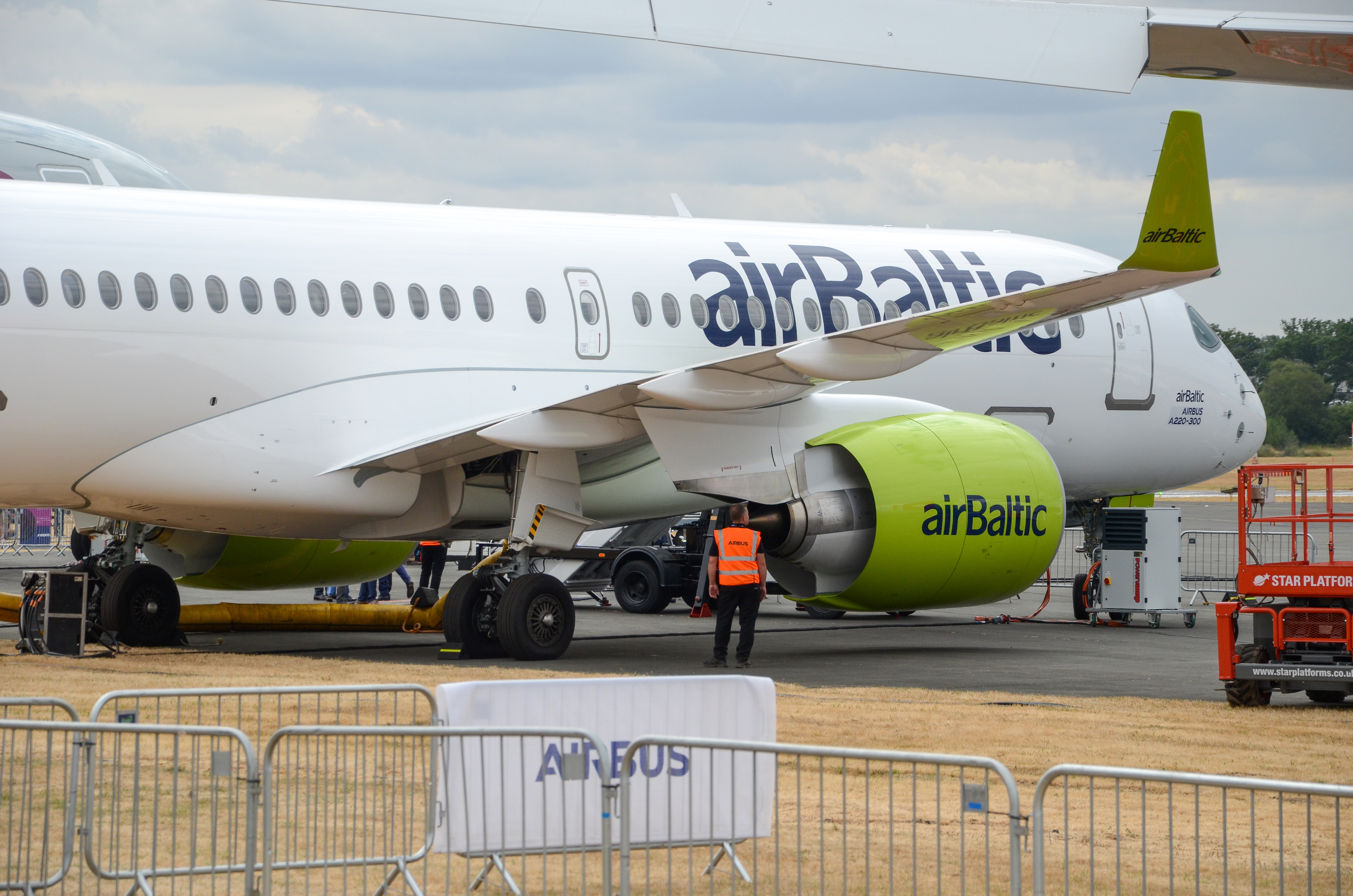 An AirBaltic Airbus A220-300 on display at the 2018 Farnborough International Airshow.