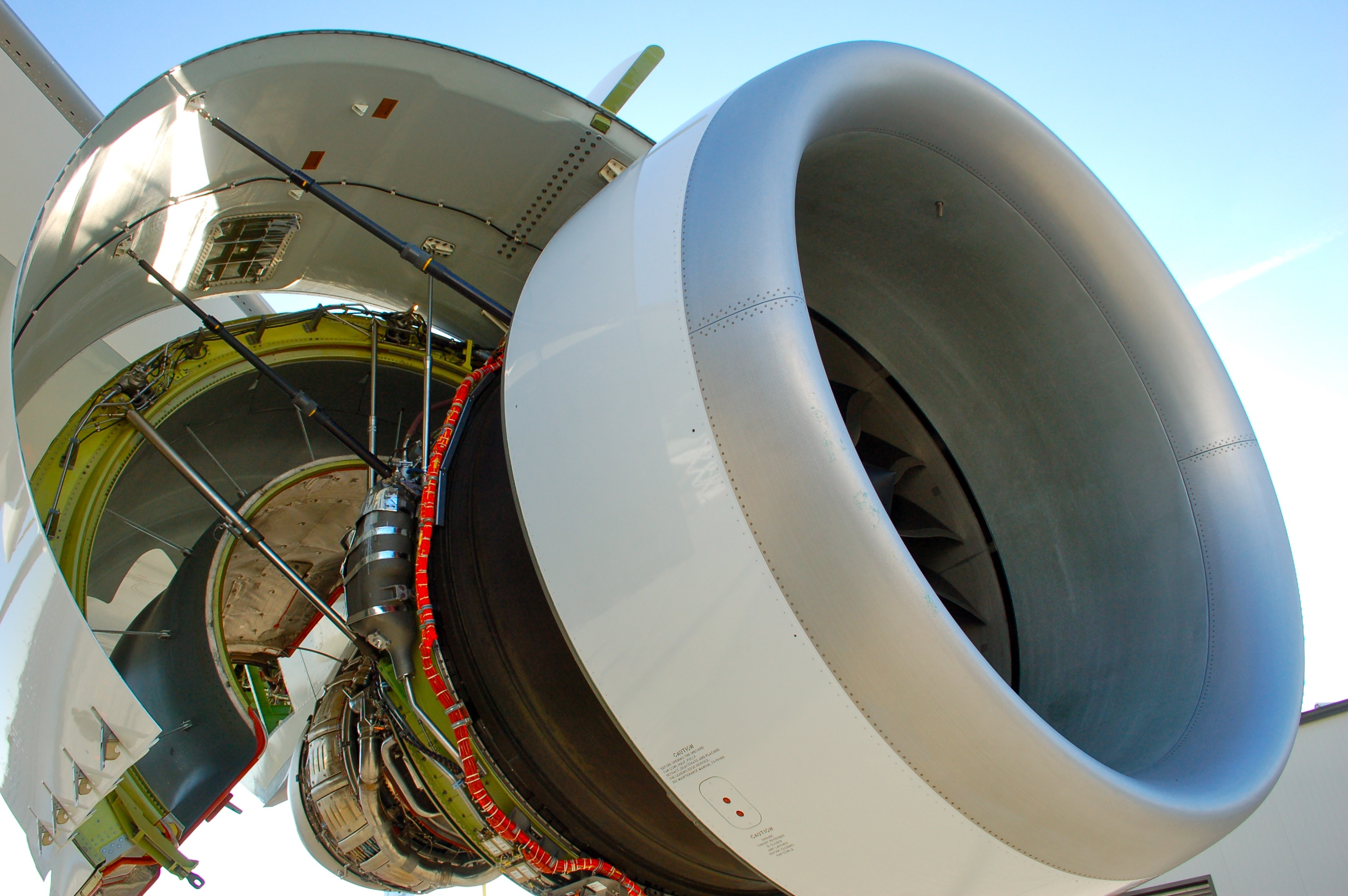 A General Electric GEnx-2B engine hangs under the wing of Boeing 747-8 on the flightline at Boeing's Paine Field factory in Everett, Wash. in 2011.
