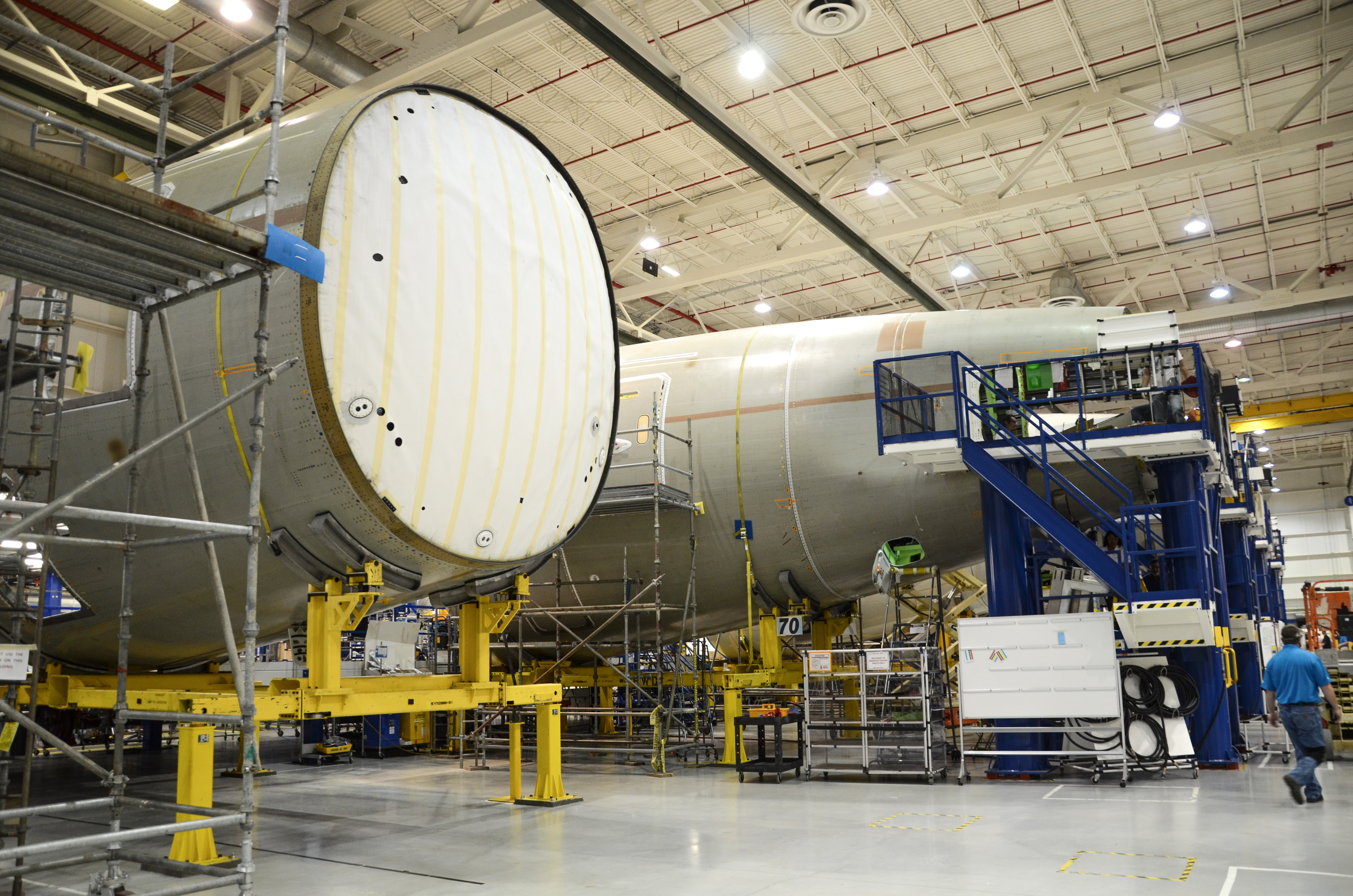 The large white structure is the pressure bulkhead inside the Section 47 barrel of the 787 Dreamliner. The unpressurized section 48 is then mated to section 48 before shipment to final assembly.