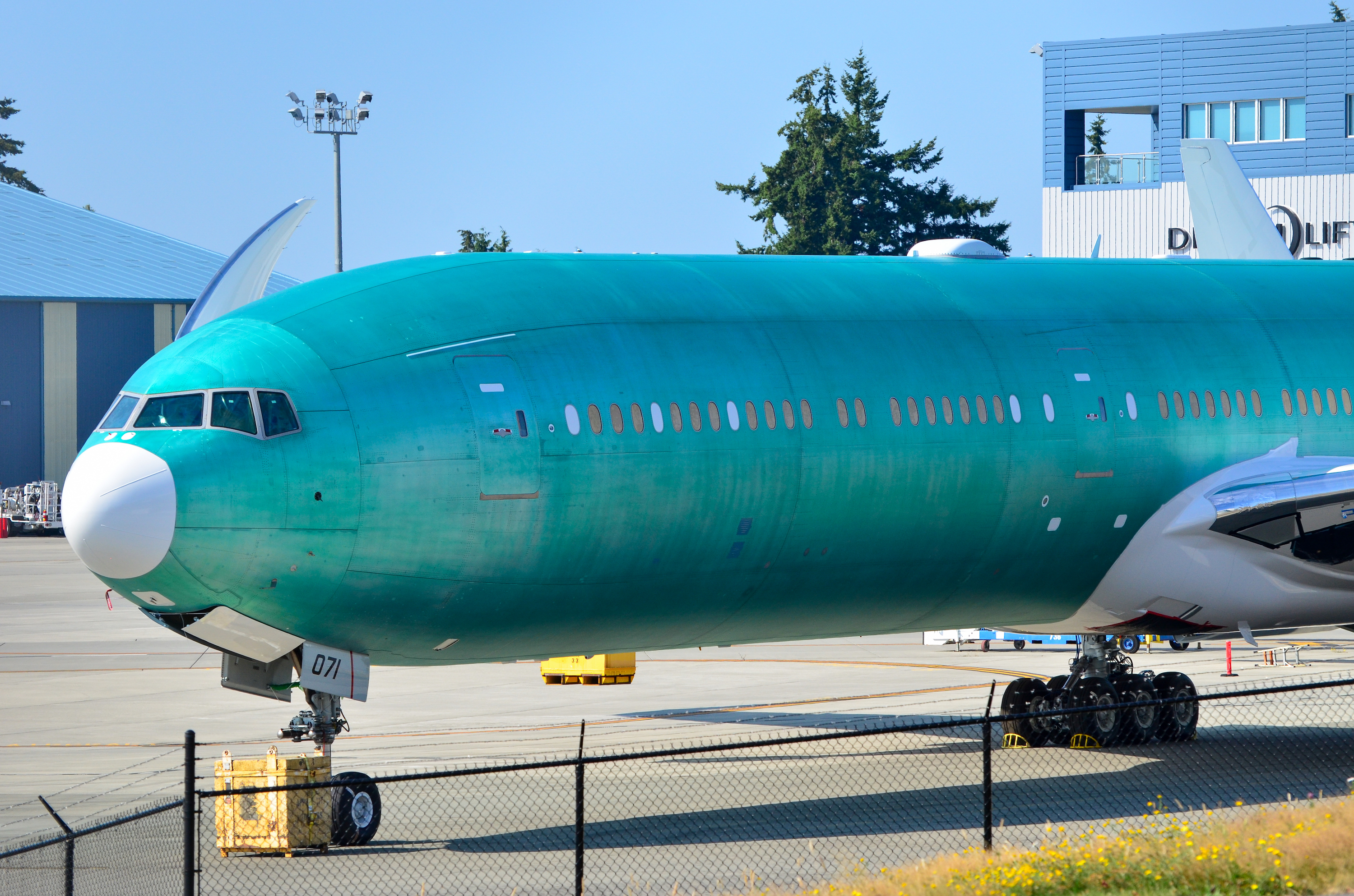 An All Nippon Airways Boeing 777-9 waits in storage at Boeing's twin-aisle assembly site in Everett, Wash.