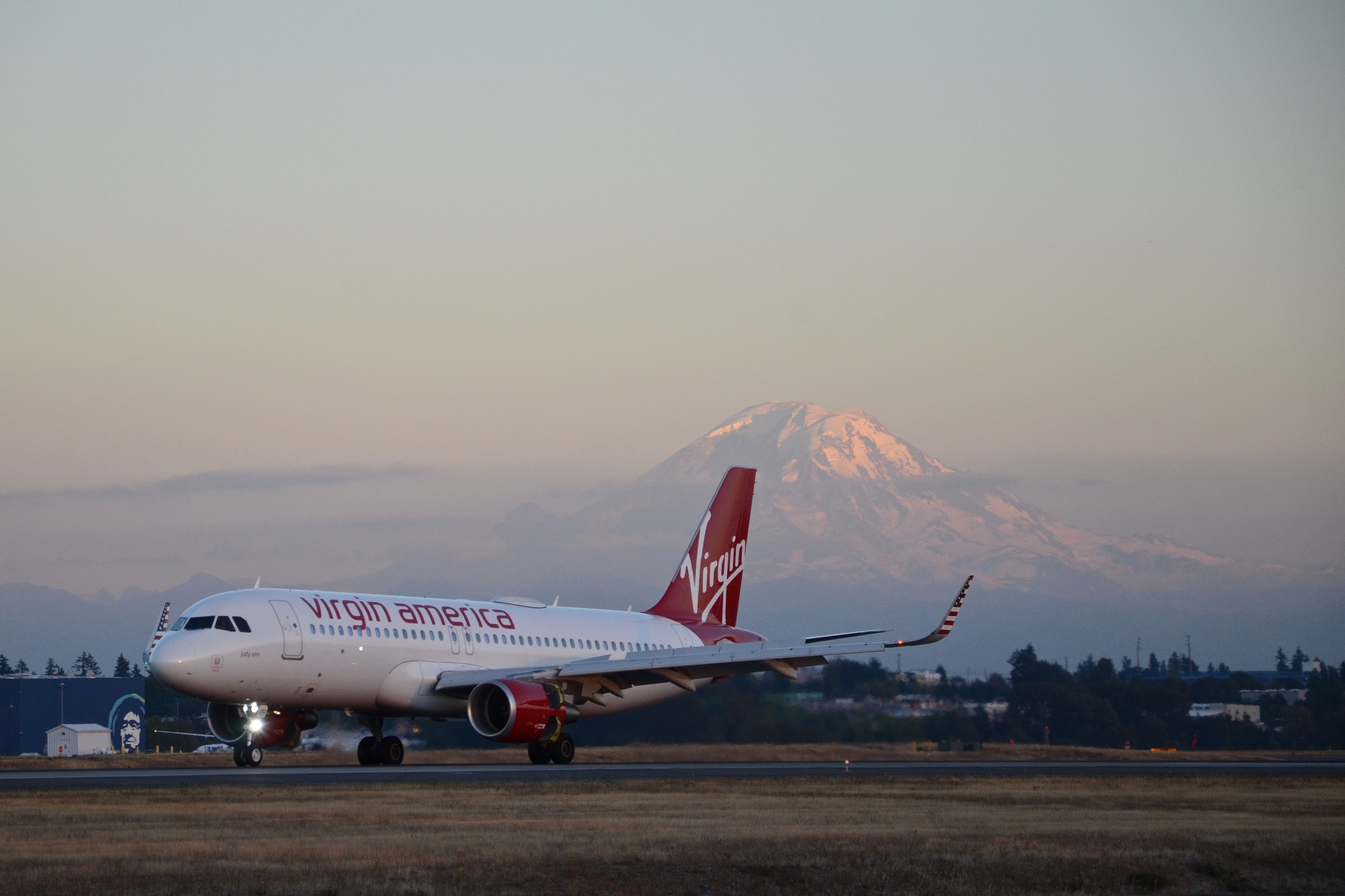 Washington state's Mt. Rainier in the background as a Virgin America Airbus A320 lands at Seattle-Tacoma International Airport in 2016.