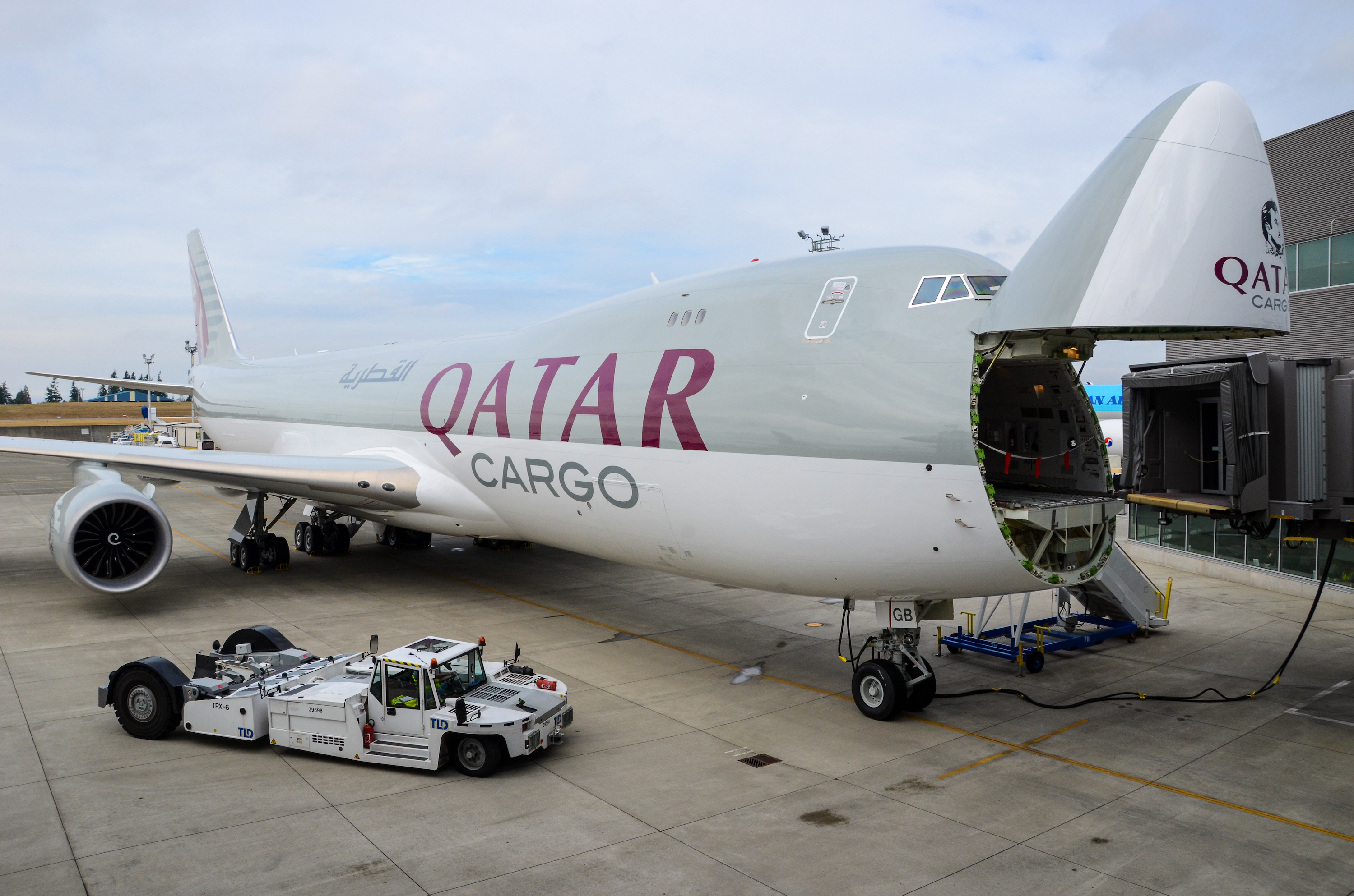 A newly-delivered Boeing 747-8F for Qatar Airways Cargo is positioned at Boeing's Delivery Center with its nose cargo door opened during a 2017 ceremony.